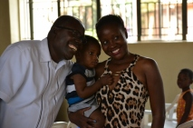 Pastor Dongo, his grandson, and his daughter Worship.
