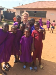 Susan with God Cares Students