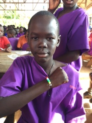 Student with her finished bracelet